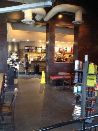 Starbucks: View As One Enters Main Door At Corner Toward Coffee Bar