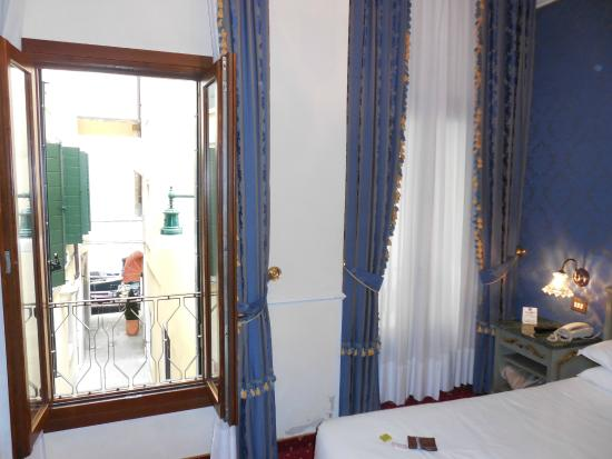 Hotel Violino d'Oro: Two windows in room looked out over tiny street to Rio Moise (canal)