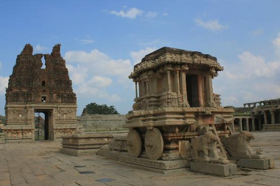 The famous stone chariot with the broken temple tower in the