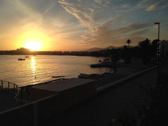 Sunset over Ibiza old town from balcony - Picture of Simbad