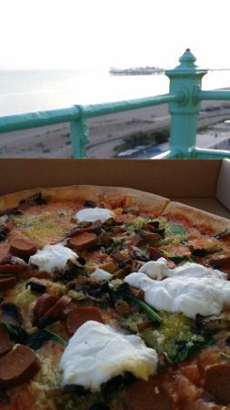 Amazing PizzaFace vegan pizza with Brighton sunset