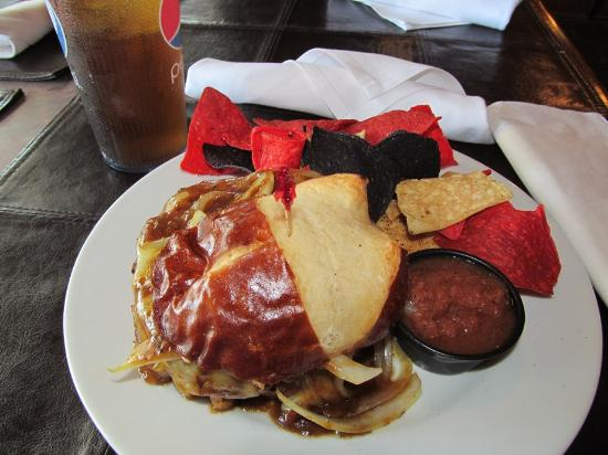Castaways: Yummy food.  Pretzel burger with chips and homemade salsa