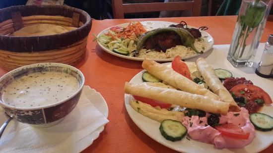 Harouns: youghurt  soup,  hummus platter and kebabs