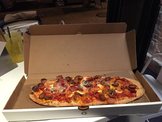 & Pizza : Maverick with spicy tomato sauce and spicy oil.
