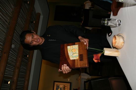 Kai Restaurant: Jackson describing the painting on the menu cover.