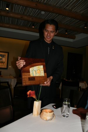 Kai Restaurant: Jackson describing the painting on the menu cover.