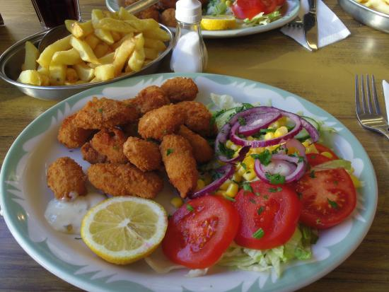 Oxford Corner: Fresh Scampi and chips cooked to order with salad
