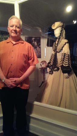 Marietta, GA: Dr. Christopeher Sullivan standing in front of the original Bengaline honeymoon gown