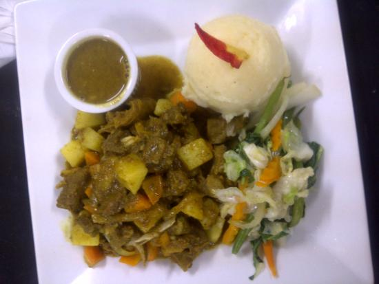 Mongoose Jamaica Restaurant and Lounge : curried goat along with garlic mash potatoes