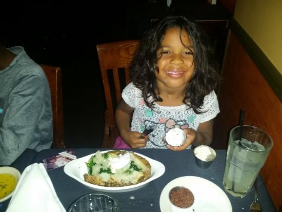 Prime Steak House & Piano Bar: the little one created has her own dish...backed potatoe topped with sauté spinach