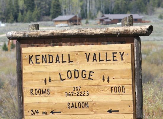Cora, WY: Main Sign with Lodge in background