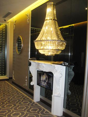 chandelier on each floor with faux fireplace nice touch picture rh tripadvisor com sg