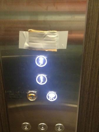 Travelodge Hotel Macquarie North Ryde: lift buttons covered with cardboard and gaff tape - classy?
