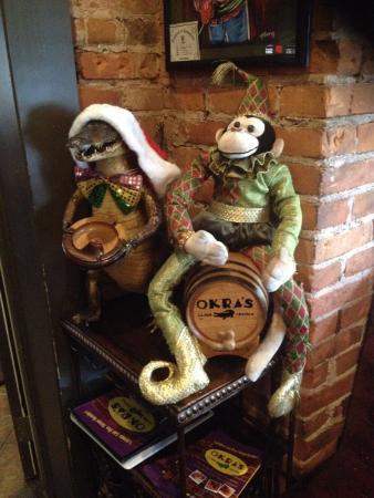 Okra's Cajun Creole : Gator and monkey dressed for Christmas
