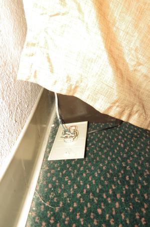 Regency Inn: Wiring for phone has fallen out of wall