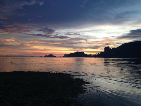 Dawn of Happiness: sunset on beachfront