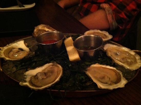 Cafe Adam Restaurant: Oyster varieties are written on chalk board daily