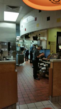 Taco Bell Kitchen kitchen. notice the person cleaning? very clean tb. - picture of