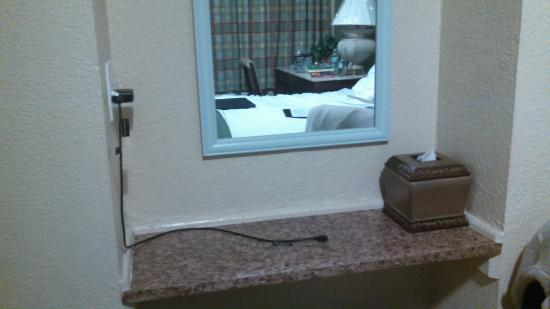 Traveler's Inn: Double Duty - Charging Station at night Vanity in Morning