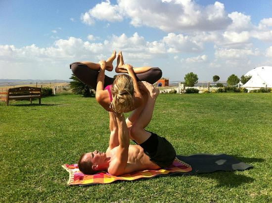 Suryalila Retreat Centre: Doing acro yoga with my wife on the grounds in front of the main building.