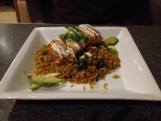 Mezcal Tequila Cantina: Pan roasted salmon entrée marinated in soy and served with rice.