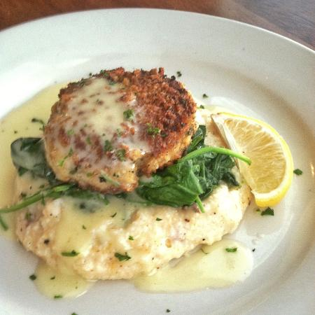 Dharma Blue: Seared Crab Cake with Lemon Beurre Blanc served over Tasso Cheddar Grits with Sautéed Spinach