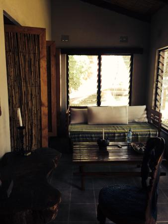 Norman Carr Cottage: Cozy and inviting to relax with a book or nap Seating area in room.