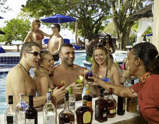 Hedonism II: Enjoy Premium Liquor at the Swim-up Bar at the Prude Beach Bar.
