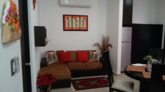 sala con cucina a vista - Foto di Playa Quinta B&B, Playa ...