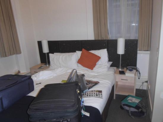 Metro Apartments on Bank Place: 30 centimetres each side of bed - tiny