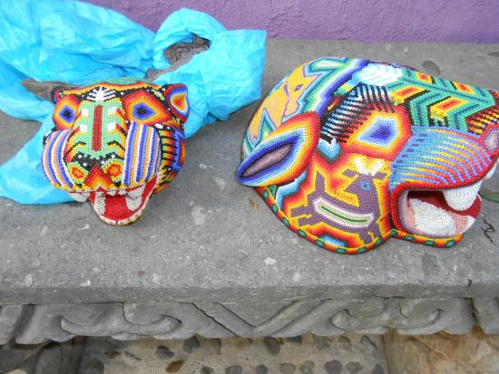 Todos Santos, Mexico: Handcrafted art...Huichol indian jaguar heads