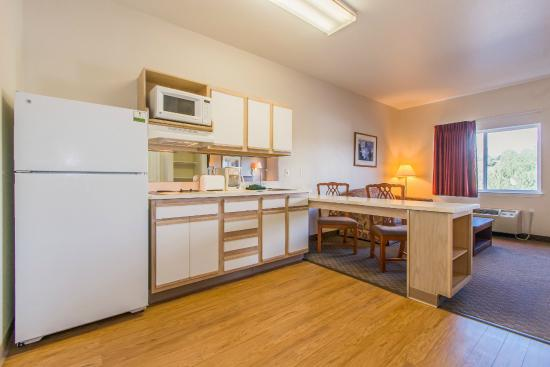 Colorado Springs Extended Stay Hotel: Kitchen with Stove, Full Size Refrigerator, Microwave, Coffee Maker
