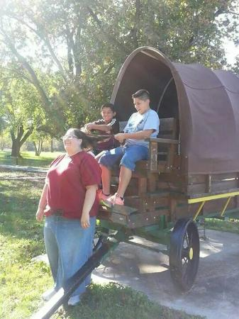 Bowling Green KOA : The front of the buggy. Cashea acting as a horse with Nojah and Nikolas holding the reins.