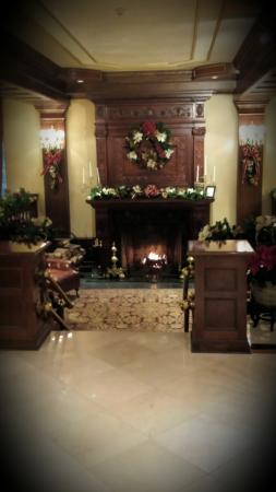 The Madison Hotel: Tiffany Fireplace in sunken lobby at Madison Hotel looks especially festive