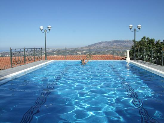 Vergis Epavlis: the crystal clear pool and the olive fields behind