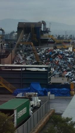 Embassy Suites by Hilton Anaheim North : Equipment loading scrap onto conveyor belt at LOUD metal scrap yard next to hotel