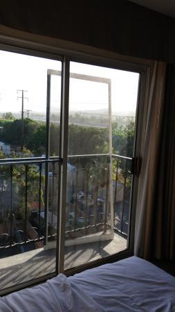 Embassy Suites by Hilton Anaheim North : Screen door blew off balcony (notice view of metal scrap yard below)