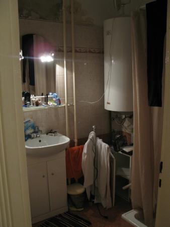 To-ma Apartments: Bathroom is adequate.  Don't take a shower if using the stove. Water heater will trip the circui