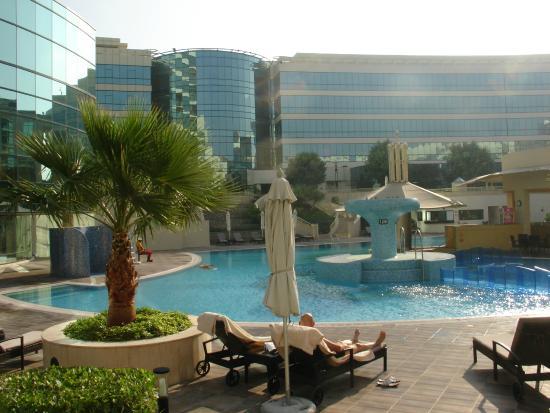 Pool area picture of millennium airport hotel dubai dubai tripadvisor for Dubai airport swimming pool price