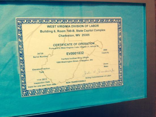 Charleston Capitol Hotel: A close up of the elevator certificate