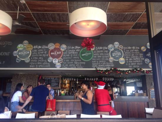 4 Pines Brewery Tours: This is the view from the patio looking in at the bar.