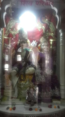 Pehowa, India: The Shiv Parvati Ganpati idols within a glass enclosure in the temple premises.