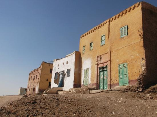 Qurna Village: View showing houses with traditional wooden doors and shutters.