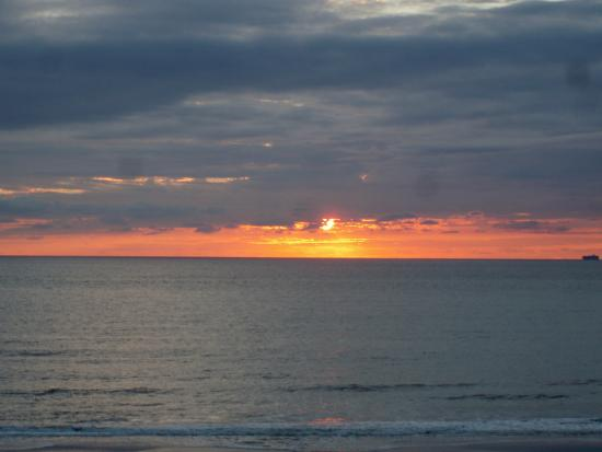 Comfort Inn & Suites Oceanfront: This was one of the sunrises viewed from our balcony.