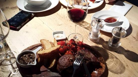The Old Bakehouse: Rib eye steak with confit cherry tomatoes & Portoballa mushrooms with a nice glass of red wine.