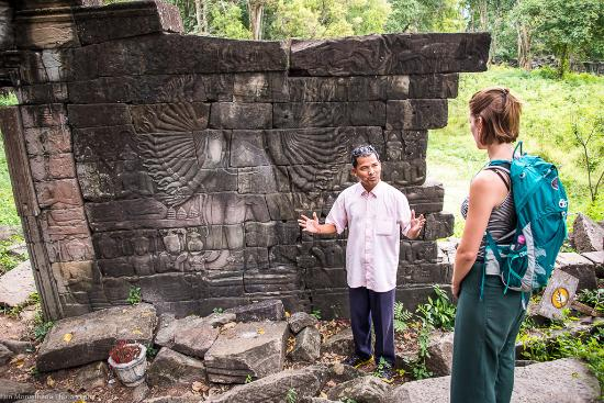 Angkor Guide Sopanha Private Tours: Sopanha explaining some of the stone carvings at Banteay Chmer, one of the most remote and impre