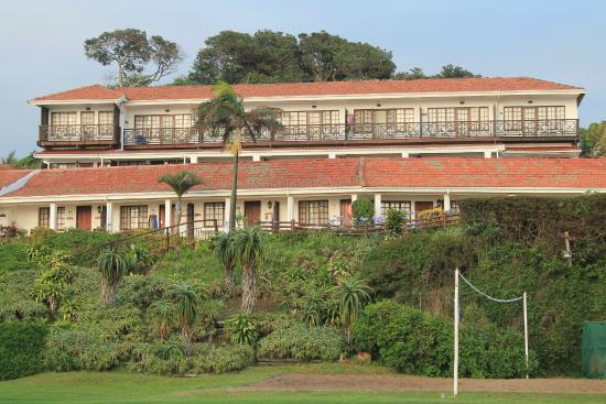 Pumula Beach Hotel: View of rooms from playing field below