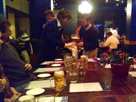 "Restaurant Linderhof: Dinner guest shares his ""boot"" of beer."