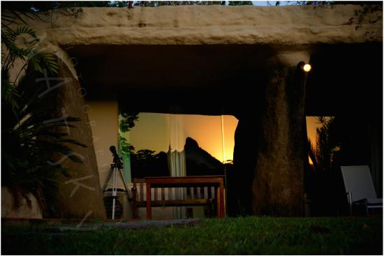 Amazing Wollumbin Palms Retreat at Mt Warning: Sunset at Wollumbin reflected into the glass front of the Earth Lodge