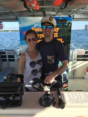 Estero Bay Express Dolphin & Sunset Boat Tours: Steering Captain Randy's boat!